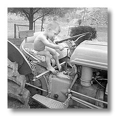Young Tyler on 9N Tractor Image
